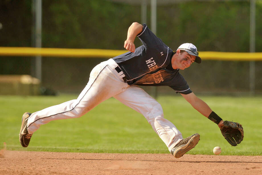 Staples shortstop Samuel Ellinwood reaches for the ball before firing towards first during the Wreckers' baseball game against Westhill at Westhill High School in Stamford, Conn., on Monday, May 19, 2014. Staples won, 9-2. Photo: Jason Rearick / Stamford Advocate