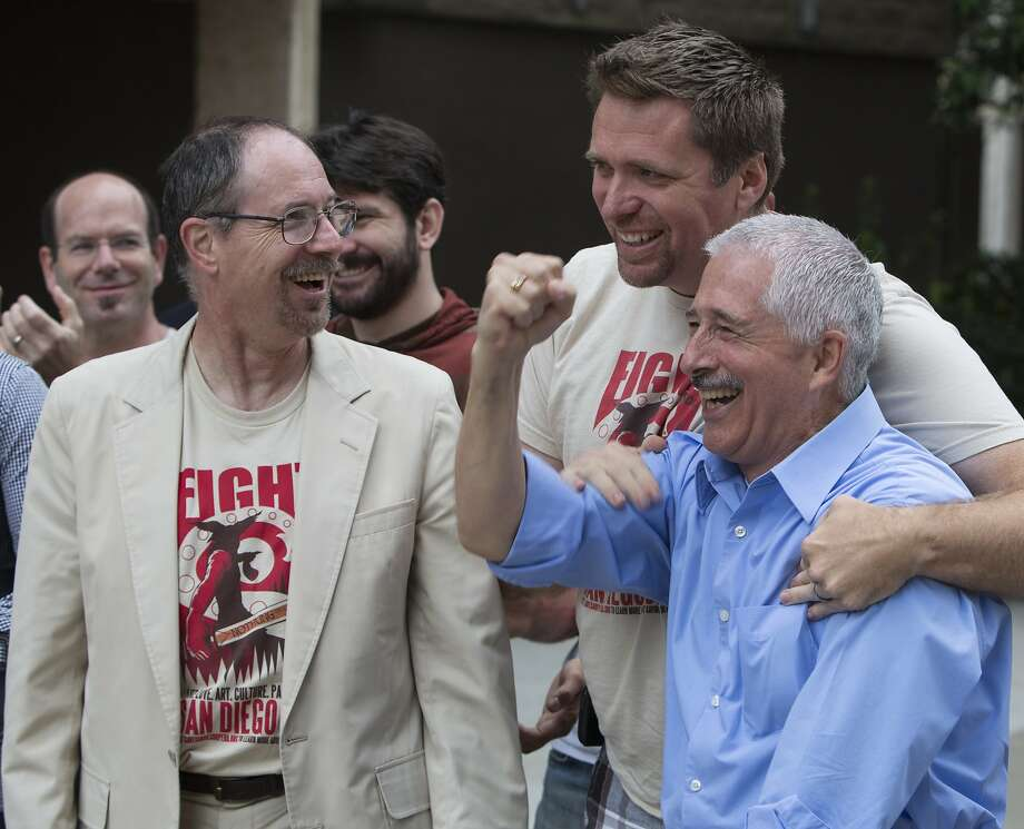 Director Nicolas Reveles, Christopher Stevens and Vincent Martin of the San Diego Opera rejoice. Photo: Christian Rodas, Associated Press