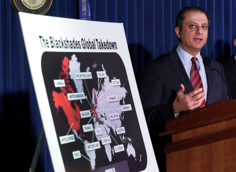 Preet Bharara, U.S. Attorney for the Southern District of New York, discusses arrests in the malware BlackShades Remote Access Too, during a news conferencel in New York, Monday, May 19, 2014. More than a half million computers in over 100 countries were infected by sophisticated malware that lets cybercriminals take over a computer and hijack its webcam, authorities said as charges were announced Monday against more than 100 people worldwide. (AP Photo/Richard Drew) ORG XMIT: NYRD112 Photo: Richard Drew / AP