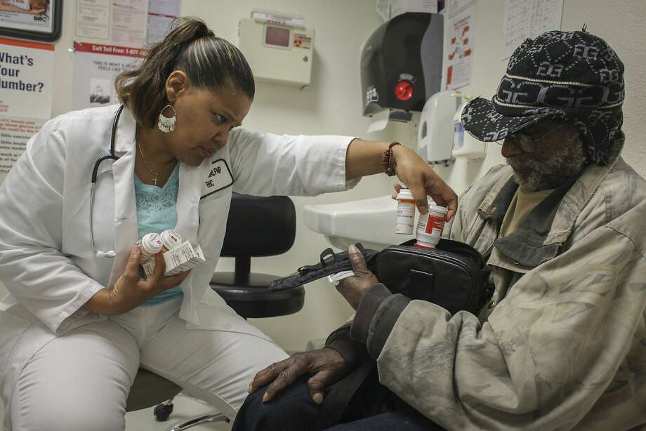 Nurse practitioner Phyllis Howard, who participated in a clinical trial, provides a monthly checkup to Lonnie Jones. Photo: Sam Wolson, Special To The Chronicle