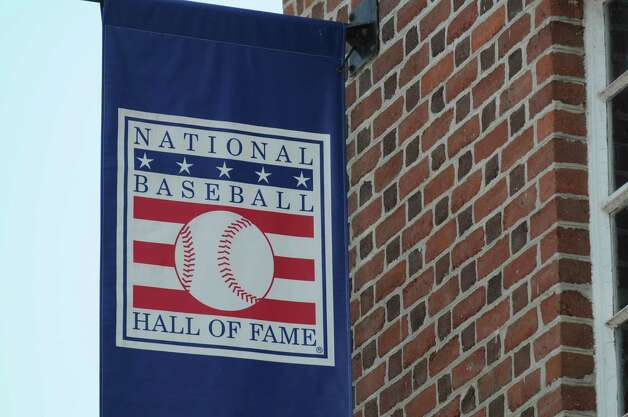 Banner hangs outside the Baseball Hall of Fame Monday, May 19, 2014, on Main St. in Cooperstown, N.Y. (Will Waldron/Times Union) Photo: WW