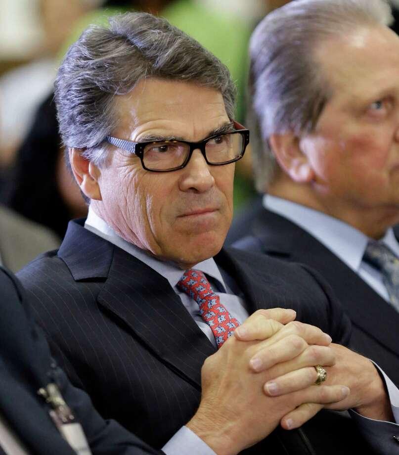 Gov. Rick Perry Photo: LM Otero, STF / AP