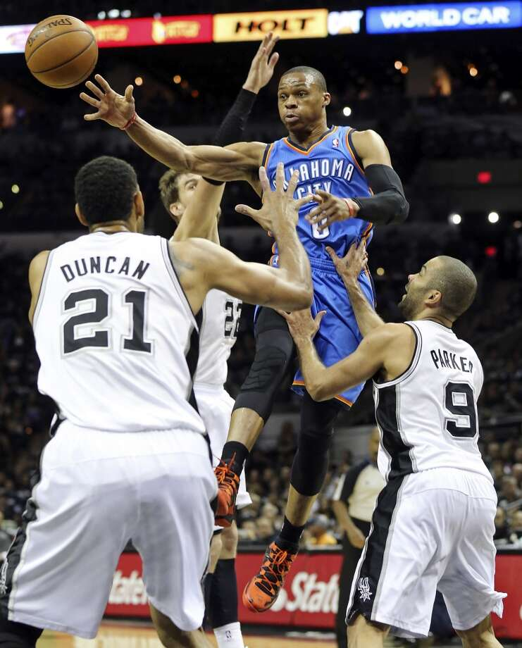 Oklahoma City Thunder's Russell Westbrook pass between San Antonio Spurs' Tim Duncan, Tiago Splitter, and Tony Parker during first half action of Game 1 in the Western Conference Finals Monday May 19, 2014 at the AT&T Center. Photo: Edward A. Ornelas, San Antonio Express-News