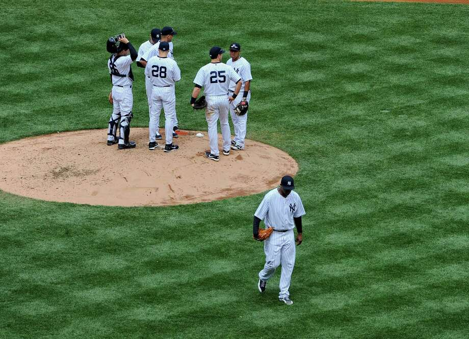New York Yankees pitcher C.C. Sabathia heads for the dugout, taken out in the fourth inning of a game with the Tampa Bay Rays, at Yankee Stadium in New York, May 4, 2014. The Rays won 5-1 in a poor performance by Yankees pitcher C.C. Sabathia. (Barton Silverman/The New York Times) ORG XMIT: XNYT114 Photo: BARTON SILVERMAN / NYTNS