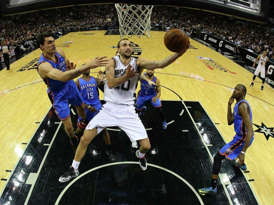SAN ANTONIO, TX - MAY 19:  Manu Ginobili #20 of the San Antonio Spurs goes up for a shot against Steven Adams #12 of the Oklahoma City Thunder in the fourth quarter in Game One of the Western Conference Finals during the 2014 NBA Playoffs at AT&T Center on May 19, 2014 in San Antonio, Texas. NOTE TO USER: User expressly acknowledges and agrees that, by downloading and or using this photograph, User is consenting to the terms and conditions of the Getty Images License Agreement. Photo: Ronald Martinez, Getty Images / 2014 Getty Images