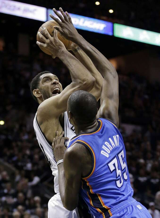 The Spurs' Tim Duncan shoots over Kevin Durant. They were the game's top scorers, with 27 and 28 points, respectively. Photo: Eric Gay, Associated Press
