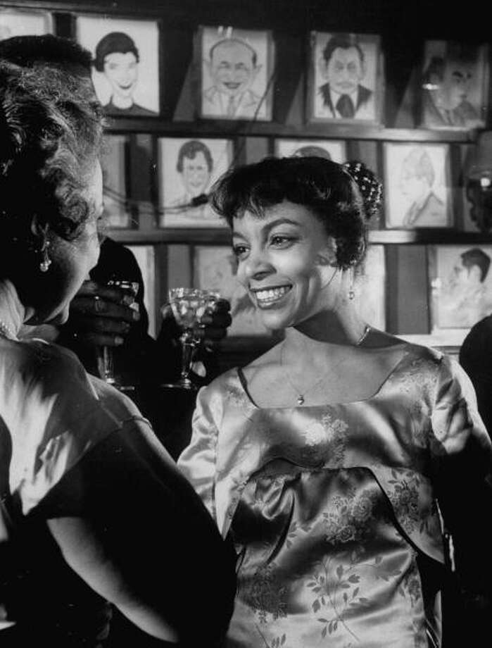 American actress Ruby Dee (R), at a party in honor of the play 'A Raisin In the Sun' March 1959. She went on to make the movie version.  The first time you see it, all eyes are on Poitier.  But watch Ruby Dee. Photo: Gordon Parks, Time & Life Pictures/Getty Image / Time Life Pictures