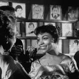American actress Ruby Dee (R), at a party in honor of the play 'A Raisin In the Sun' March 1959. She went on to make the movie version.  The first time you see it, all eyes are on Poitier.  But watch Ruby Dee.