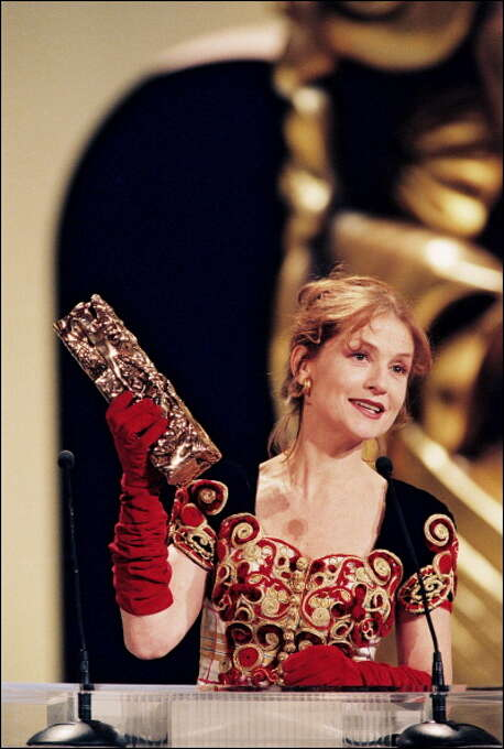 "March 01, 1996 - Isabelle Huppert wins the Cesar Award for Best Actress in ""La ceremonie"" by Claude Chabrol.  Also see her in THE PIANO TEACHER. Photo: Pool APESTEGUY/STEVENS, Gamma-Rapho Via Getty Images / 2011 Gamma-Rapho"