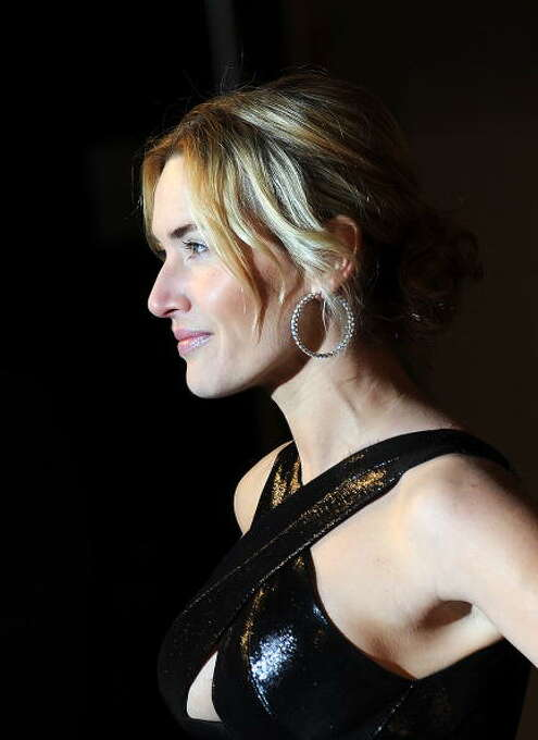 Kate Winslet arrives for the European Premiere of 'Revolutionary Road' at the Odeon Leicester Square on January 18, 2009 in London, England. This is the Winslet role that gives you everything you want from Kate Winslet -- psychological acuity, strength, honesty, rage . . . Also see her in LITTLE CHILDREN. Photo: Samir Hussein, Getty Images / 2009 Samir Hussein