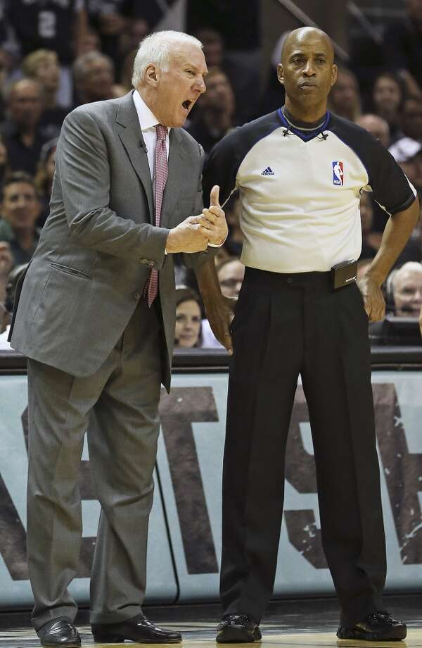Greg Popovich makes a complaint about officiating to the ref in the second half as the Spurs play the Thunder in the opener of the NBA Western Conference finals at the AT&T Center on May 19, 2014. Photo: TOM REEL, San Antonio Express-News