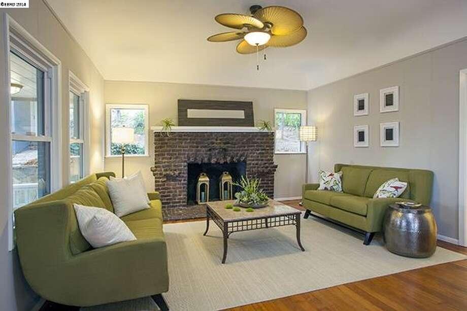 The living room, with brick fireplace. Photo: Steve Labadassa
