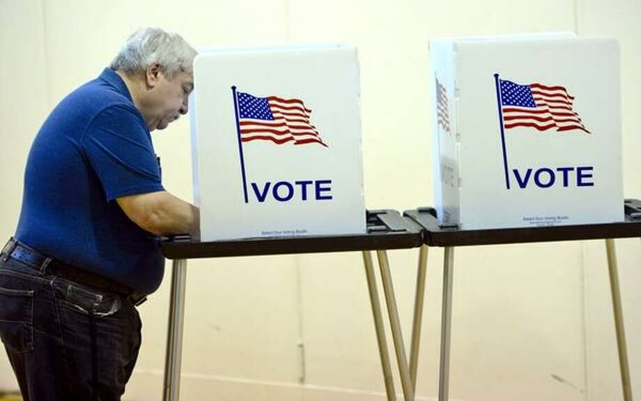 Anthony Migliozzi casts his vote at Division Street School in Saratoga Springs on Tuesday, the day voters across the state head to the polls. (Skip Dickstein / Times Union)