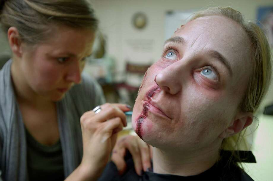 "Bernadette Gulyas, 36, of Norwalk, volunteered to be a subject for her sister-in-laws theater, film, and television techniques in special effect makeup class on Monday night, May 19, 2014, where student Jessica Mercier, 28, of Hartford, applies a ""Ghoul"" effect to her face.  Allison L. Sammel, 32, of Danbury, owns La Bella School in Bethel, Conn, where she teaches students to be makeup artists and stylists. Photo: H John Voorhees III / The News-Times Freelance"