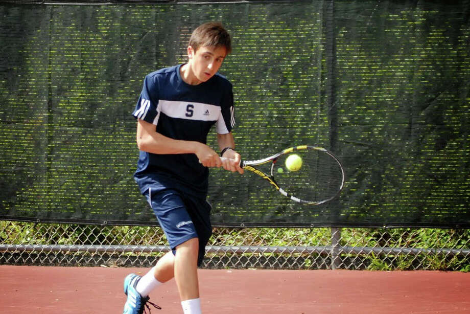 Staples freshman Max Zimmerman returns a shot during match on Monday at Greenwich High School. Zimmerman's win over Axel Hebrand (6-7, 6-2, 6-4) clinched the Wreckers' undefeated regular season. Photo: Keith Stein/Contributed / Westport News Contributed