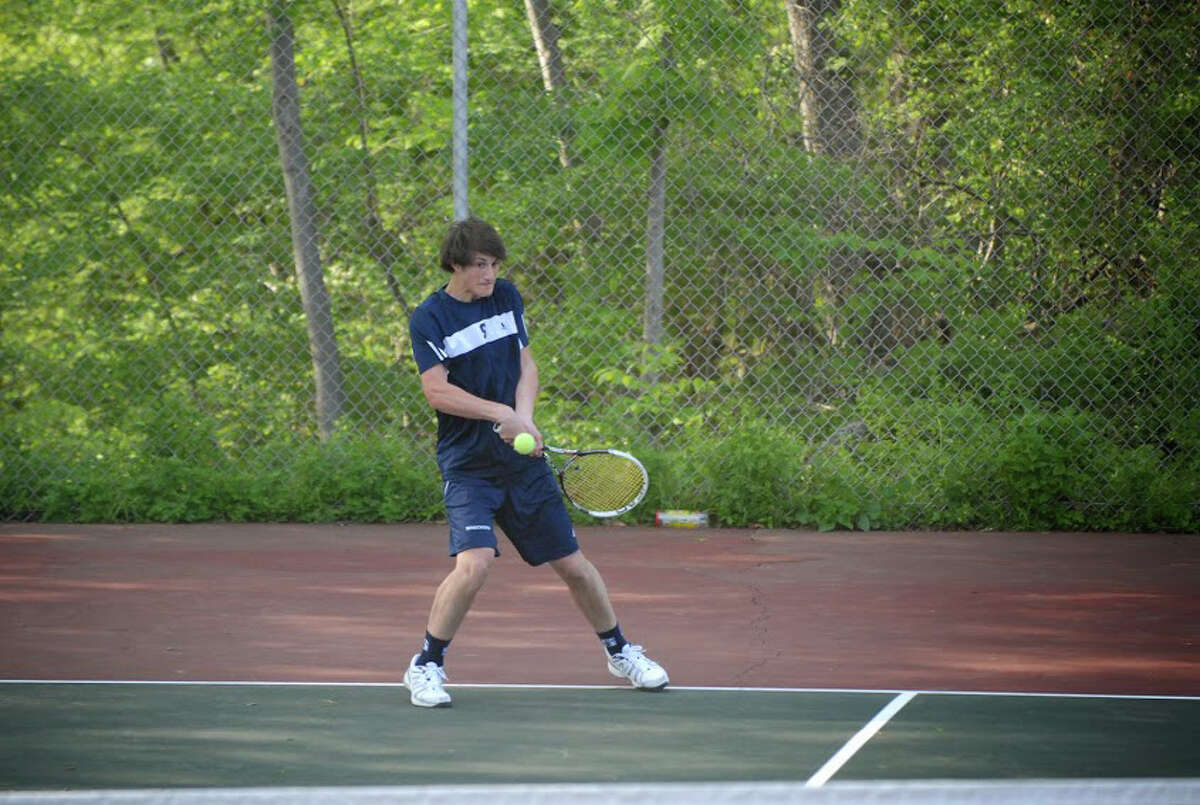 Staples Connor Mitnick returns a shot against Greenwich's Marcos Eslava during match on Monday at Greenwich High School.