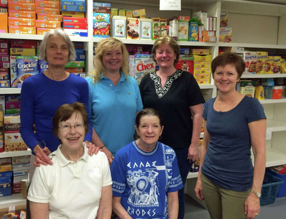 The Hannah Benedict Carter Chapter, NSDAR, assisted in sorting and restocking the New Canaan Food Pantry shelves on Monday, May 12, 2014. The donations from town residents filled 120 USPS boxes. Back row from left, Marcy McKee, Cathy Kulkin, Carrie Sindelar and Kathleen Tesluk. Front row, Barbara Wagner and Marge Pavlov. Photo: Contributed Photo, Contributed / New Canaan News Contributed