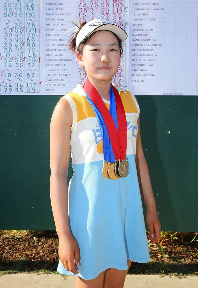 Girls 10-11 age group overall winner and drive contest winner Lucy Li poses for a photograph during the regional finals of the Drive, Chip and Putt Championship at Morongo Golf Club at Tukwet on August 17, 2013 in Beaumont, California. Photo: Victor Decolongon, Getty Images