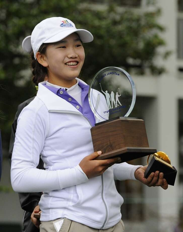 Girls 10-11 category champion Lucy Li from Redwood City, California poses with her trophy during the National Finals of the 2014 Drive, Chip and Putt Championships  April 6, 2014 at Augusta National Golf Club Augusta, Georgia. Created by the Masters Tournament Foundation, United States Golf Association (USGA) and The PGA of America. Photo: Timothy A. Clary, AFP/Getty Images
