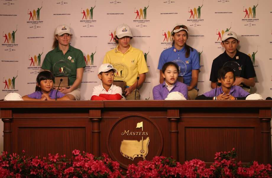 (Left to right) Front row: Kelly Xu, Treed Huang, Lucy Li, Leo Cheng;  Back row: Natalie Pietromonaco, Bryson Bianco, Hunter Pate and Patrick Welch face the media after winning their categories in the National Finals of the Drive, Chip and Putt Championship at Augusta National Golf Club on April 6, 2014 in Augusta, Georgia. Photo: Andrew Redington, Getty Images