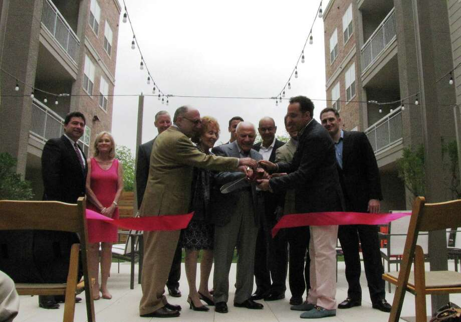 3N Group President Guillermo Nicolas, front right with big scissors, gathers with family and business partners May 6 to formally open the 1111 Austin Highway apartment community. Photo: Edmond Ortiz / Alamo Heights Weekly