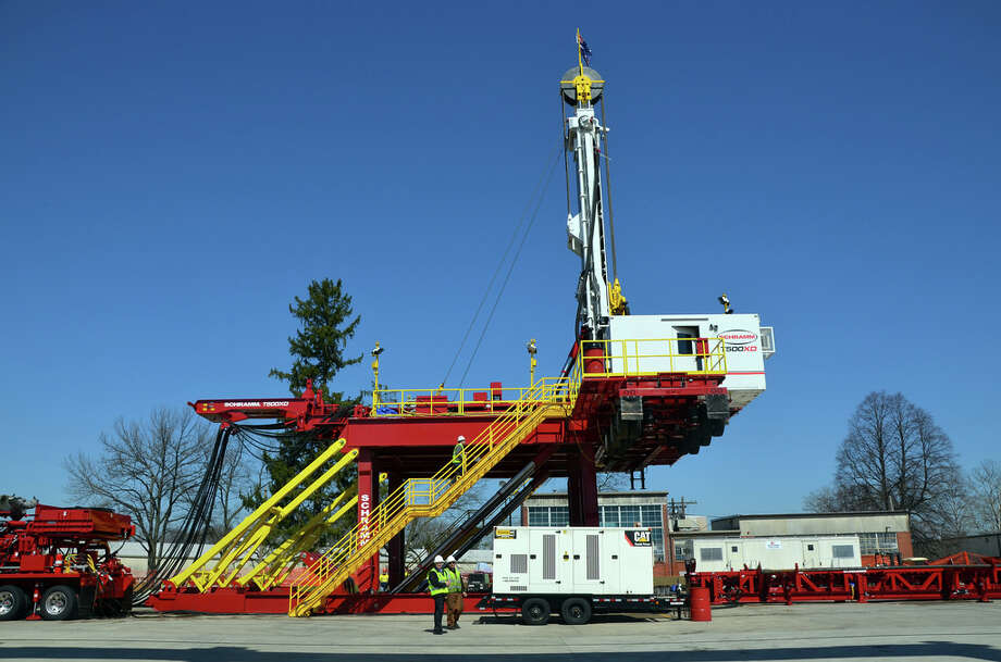 Schramm Inc. workers conduct a final series of tests on its T500XD drilling rig, before breaking it down and shipping it to Australia. This is the second T500XD Telemast drill rig manufactured by Schramm. The company built a new test pad at its West Chester, Pa., manufacturing site to accommodate the product. Photo: Jennifer A. Dlouhy, Houston Chronicle