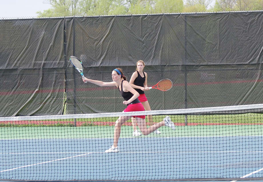 New Canaan's Emily Brand and Sarah Lovejoy compete in the No. 1 doubles match of Monday's home girls tennis match against Darien. Photo: Dave Crandall / New Canaan News freelance