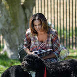 U.S. first lady Michelle Obama with Bo and Sunny.