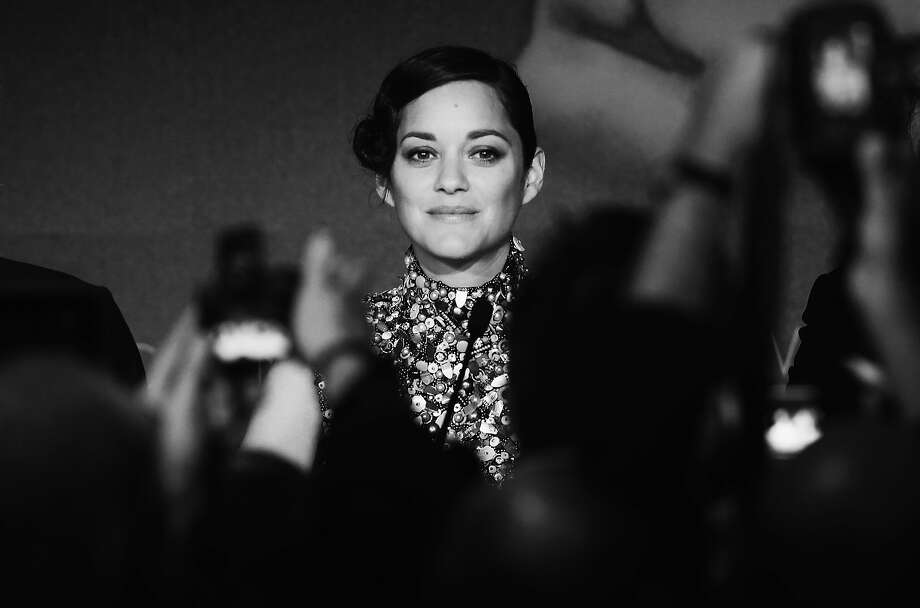 Actress Marion Cotillard attends the 'Two Days, One Night' (Deux Jours, Une Nuit) press conference during the 67th Annual Cannes Film Festival on May 20, 2014 in Cannes, France. Photo: Vittorio Zunino Celotto, French Select Via Getty Images,