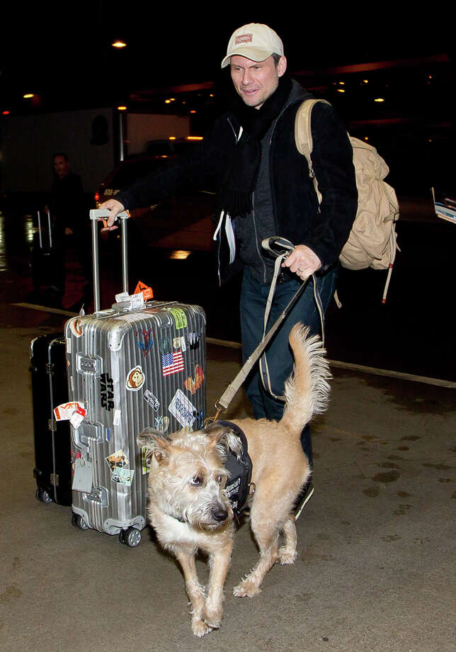Christian Slater with his dog at LAX airport on March 01, 2014 in Los Angeles. Photo: GVK/Bauer-Griffin, Getty Images / 2014 Bauer-Griffin