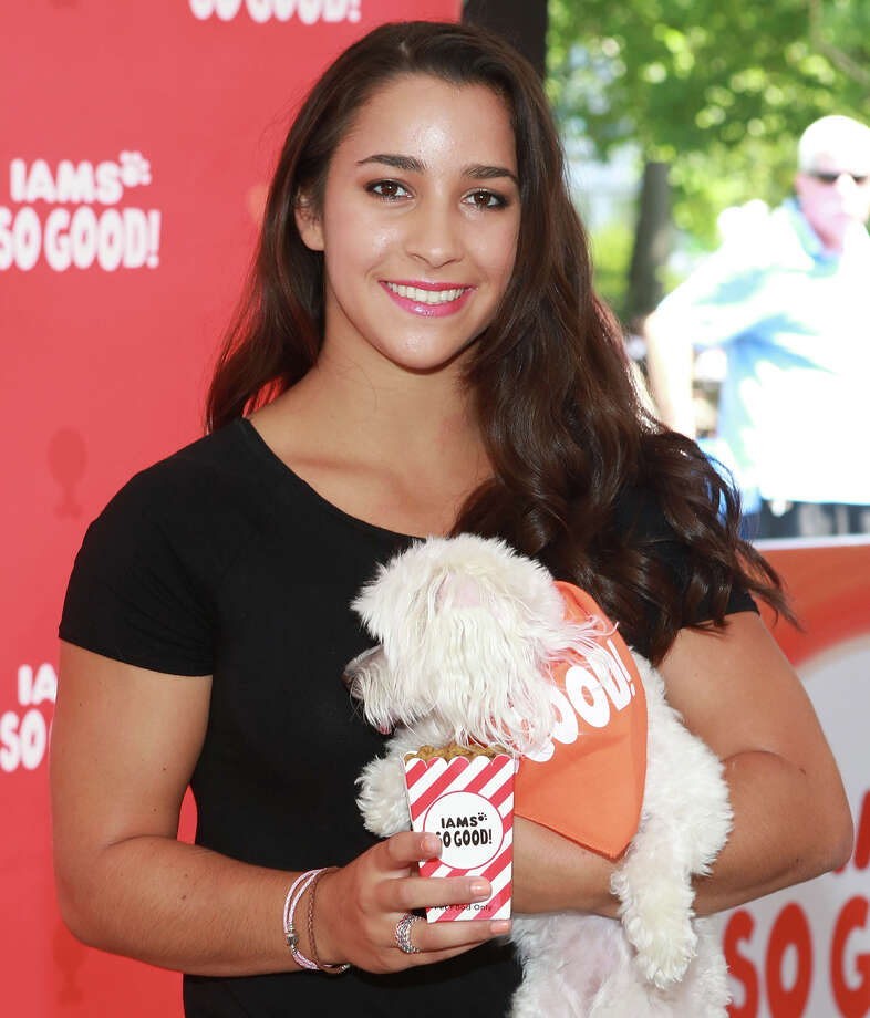"Olympic gold medalist Aly Raisman with her dog Coco attends ""IAMS So Good"" Event at Union Square on July 30, 2013 in New York City. Photo: Robin Marchant, Getty Images / 2013 Robin Marchant"