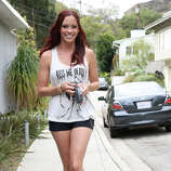 Recording artist / actress Jessica Sutta is seen walking her dog on March 7, 2013 in Los Angeles.