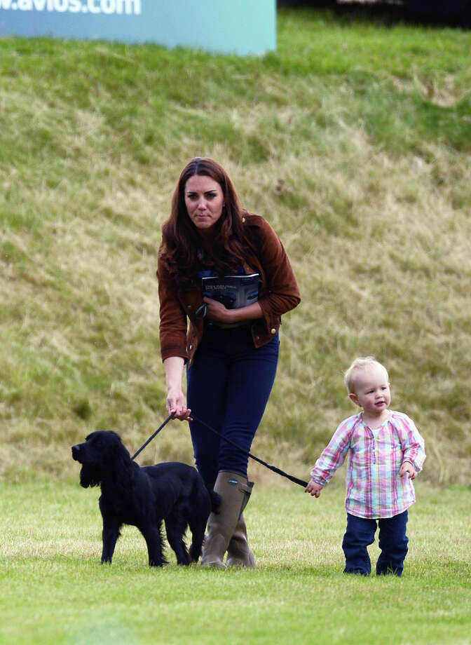 Catherine, Duchess of Cambridge walks Lupo with Savannah Phillips, daughter of Peter and Autumn Phillips at the Beaufort Polo Club on June 17, 2012 in Tetbury, England. Photo: Anwar Hussein, Getty Images / 2012 Anwar Hussein