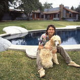 Actor and dancer Patrick Swayze poses for a portrait with his dog at home in 1987 in Los Angeles.