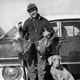 Roy Rogers and his hunting dog.
