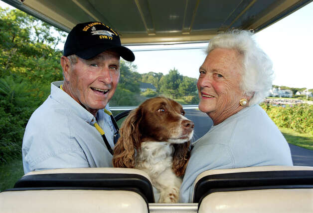 Former U.S. president George H. W. Bush and wife, Barbara Bush, cruise in the back of a golf cart with their dog Millie at their home at Walker's Point August 25, 2004 in Kennebunkport, Maine. Photo: David Hume Kennerly, Getty Images / 2004 David Hume Kennerly