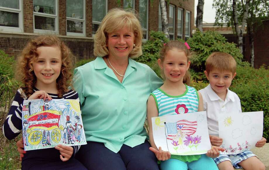 The winners of the second annual Memorial Day parade Children's Drawing Contest, showing off their artwork with Selectman Susan Marks, are from left, Alexandra Martin, Caroline Gies and Ian Schneeberger. Photo: Contributed Photo, Contributed / Darien News