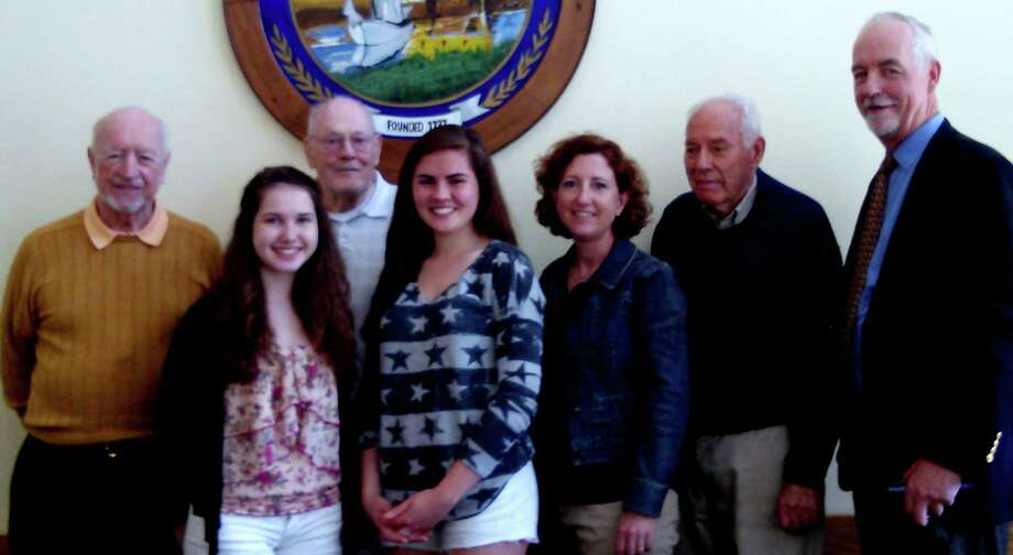 The Darien Monuments and Ceremonies Commission recently completed its 2014 Memorial Day essay contest. From left, George Walsh; Kathleen McIlree, a winner; John Geoghegan; Katy Murphy, a winner; Sueann Schorr; Chick Scribner; and Terry Gaffney. Photo: Contributed Photo, Contributed / Darien News