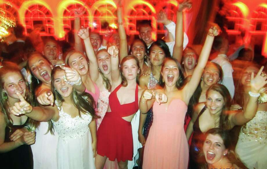 "Enthusiasm for a good time was in ample supply during ""Casino Royale,"" New Milford High School's Senior Prom at the Waterview in Monroe, May 17, 2014. Photo: Norm Cummings / The News-Times"