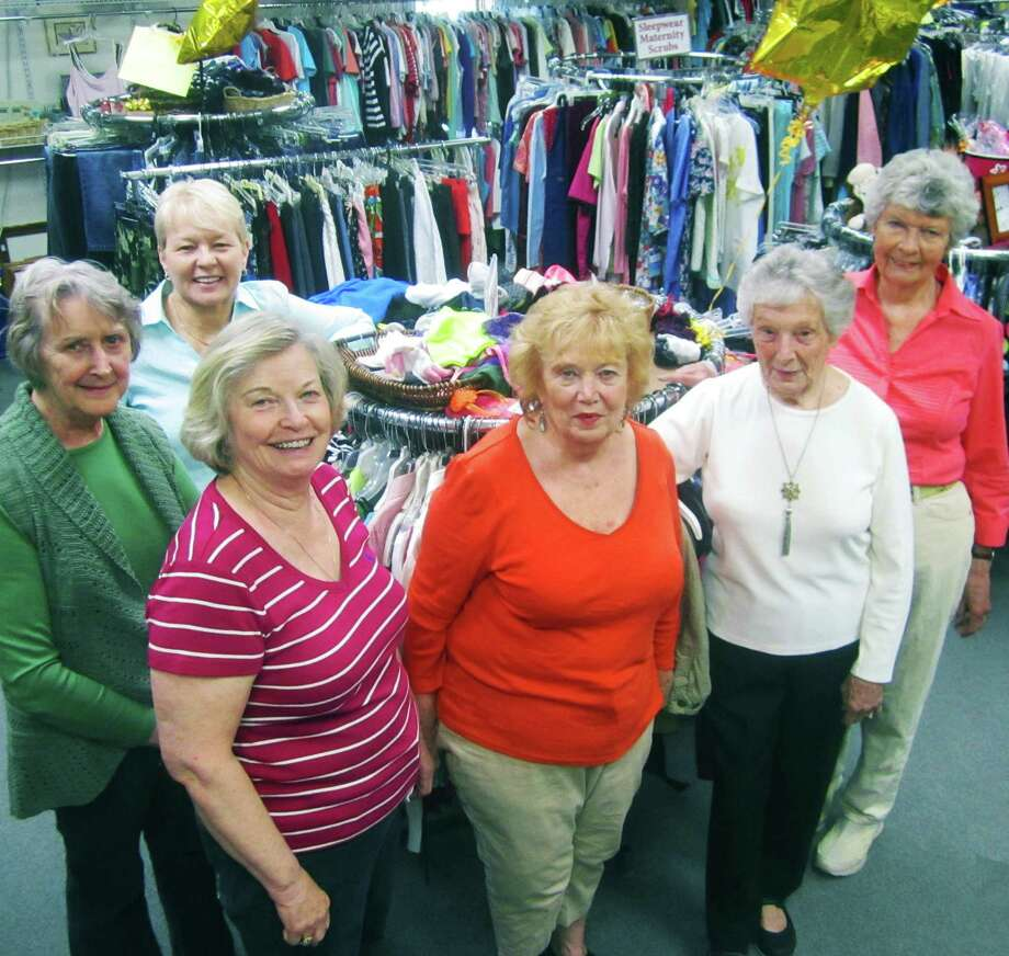 Among the dedicated volunteers who guide the Thrift Mart of New Milford as it heads into its seventh decade of service are board members, counter-clockwise from the back left, Judith Janewicz, treasurer; Kathy Hyland, 1st vice president; Sue Metcalf, president; Mary Jane Burr, vice president; Doris Curtiss, finance committee; and Laura McCormick, finance committee. May 2014 Photo: Norm Cummings / The News-Times
