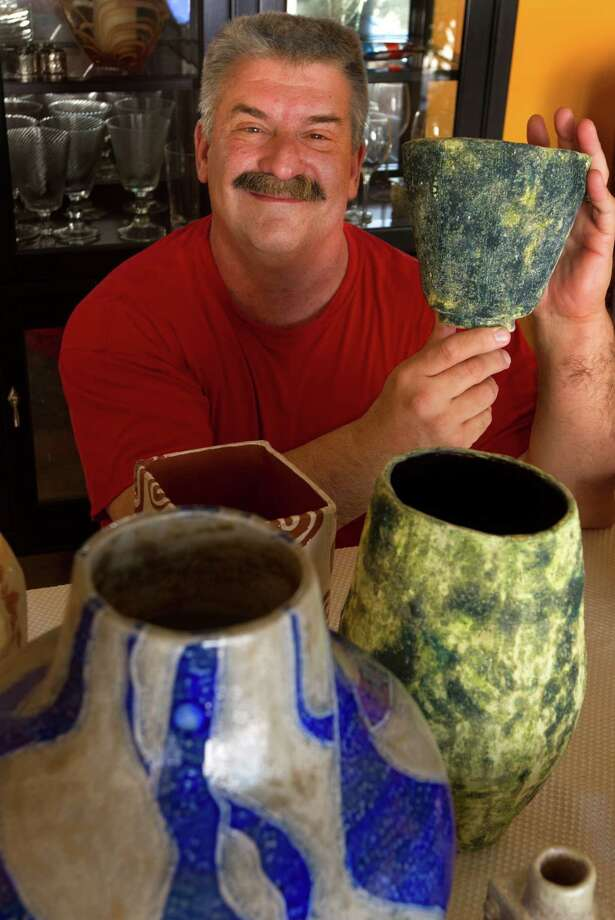 Tony Vanchu poses for a portrait with some of his pottery at his home on Wednesday, May 14, 2014, in Seabrook. ( J. Patric Schneider / For the Chronicle ) Photo: J. Patric Schneider, Freelance / © 2014 Houston Chronicle