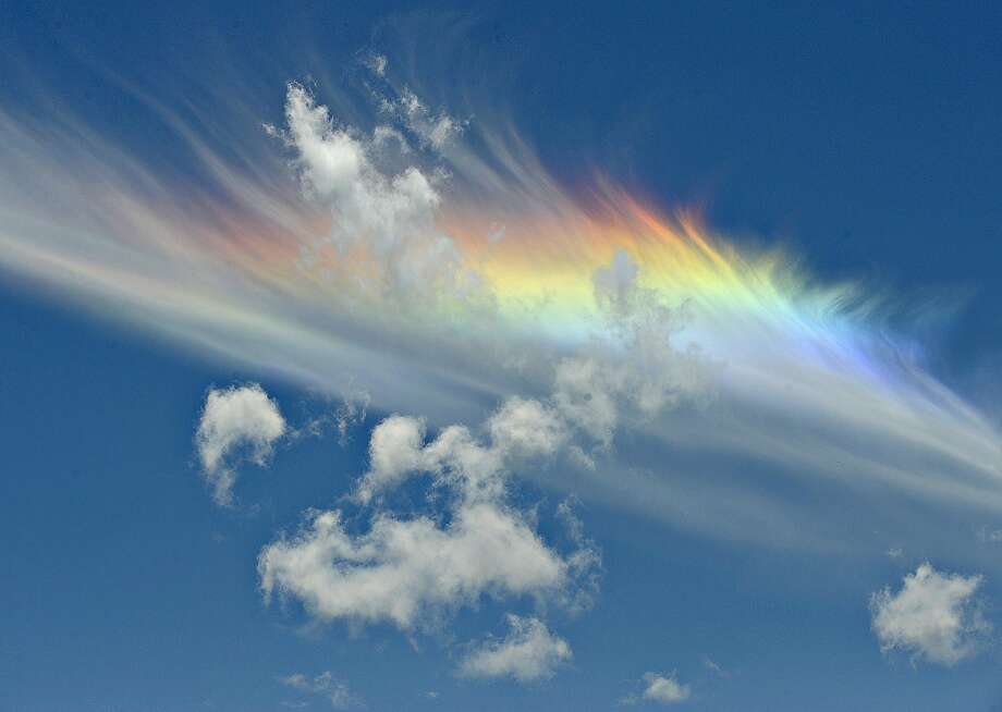 A rainbow colors a cloud south of Corvallis, Ore. Photo: Andy Cripe, Associated Press