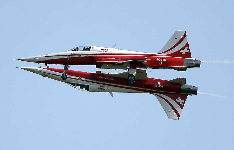 You can be my wingman any time, Maverick:Two Northrop F-5E Tiger IIs of the Swiss Patrol get uncomfortably close during an aerobatic performance at the ILA Berlin Air Show. Photo: Michael Sohn, Associated Press