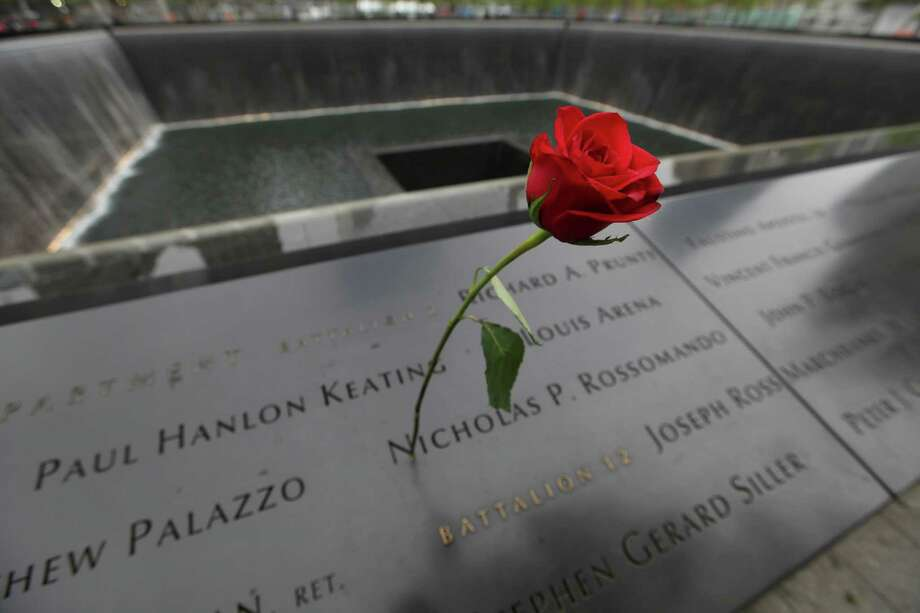 FILE PHOTO: A rose is placed on a name engraved along the South reflecting pool at the Ground Zero memorial site during the dedication ceremony of the National September 11 Memorial Museum in New York on Thursday, May 15, 2014. (AP Photo/Allan Tannenbaum, Pool) Photo: Allan Tannenbaum, Associated Press / Pool Polaris Images