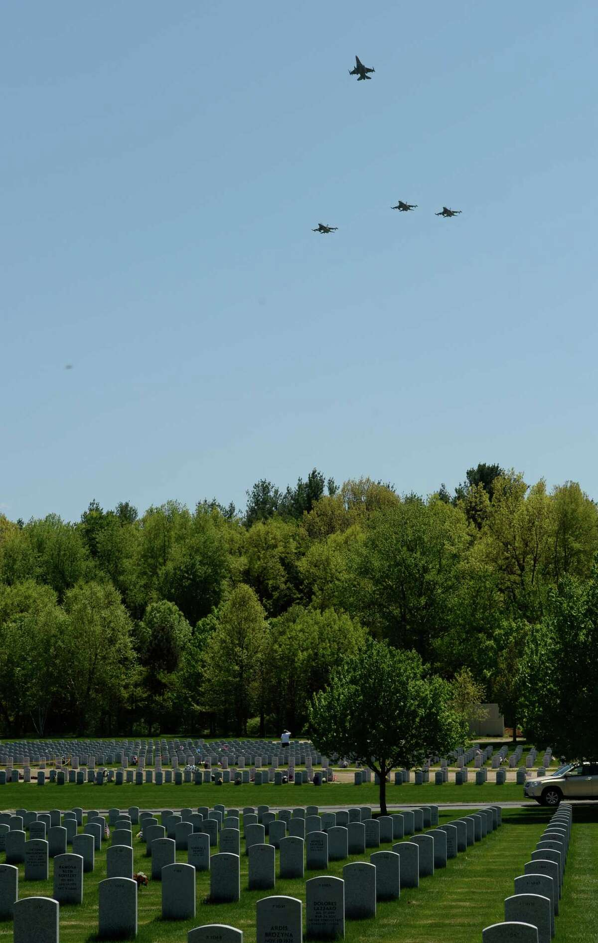 Members of the 158th Fighter Wing known as the Green Mountain Boys perform the missing man formation in the skies above the Gerald B.H. Solomon National Cemetery during burial services for Major General Robert Knauff Tuesday afternoon, May 20, 2014, in Stillwater, N.Y. The retired Maj. Gen. was a former Commander of the N.Y. Air National Guard. (Skip Dickstein / Times Union)