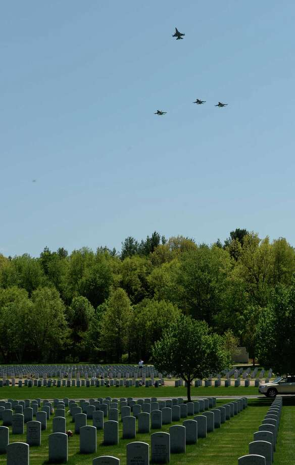 Members of the 158th Fighter Wing known as the Green Mountain Boys perform the missing man formation in the skies above the Gerald B.H. Solomon National Cemetery during burial services for Major General Robert Knauff Tuesday afternoon, May 20, 2014, in Stillwater, N.Y. The retired Maj. Gen. was a former Commander of the N.Y. Air National Guard. (Skip Dickstein / Times Union) Photo: SKIP DICKSTEIN / 00026971A