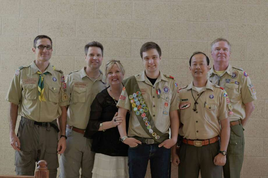 Attending Evan Carothers' Boy Scout Court of Honor were, from left, Mark Coalmer, former scoutmaster, Troop 826, Manama, Bahrain; Mark and Karen Carothers, Evan's parents; Evan; Long Pham, former Scoutmaster Troop 38; and Steve Frantz, former Scoutmaster, Troop 38.    Attending Evan Carothers' Boy Scout Court of Honor were, from left, Mark Coalmer, former scoutmaster, Troop 826, Manama, Bahrain; Mark and Karen Carothers, Evan's parents; Evan; Long Pham, former Scoutmaster Troop 38; and Steve Frantz, former Scoutmaster, Troop 38. Photo: Courtesy