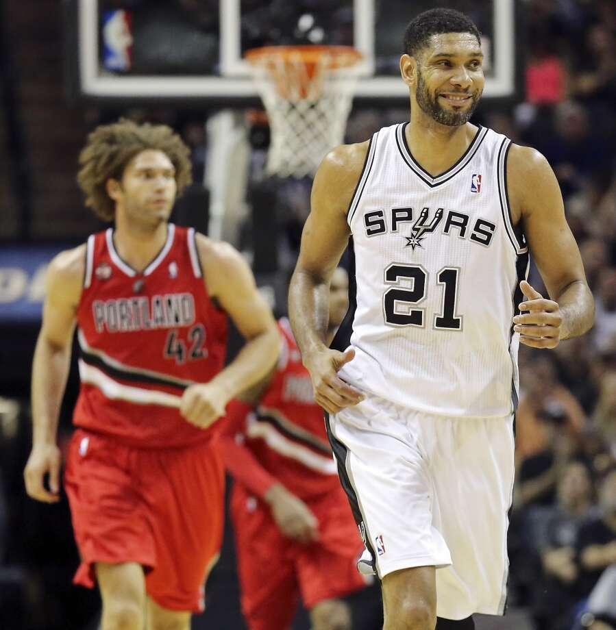 San Antonio Spurs' Tim Duncan reacts after scoring during second half action of Game 5 in the Western Conference semifinals against the Portland Trail Blazers Wednesday May 14, 2014 at the AT&T Center. The Spurs won 104-82. Photo: Edward A. Ornelas, San Antonio Express-News
