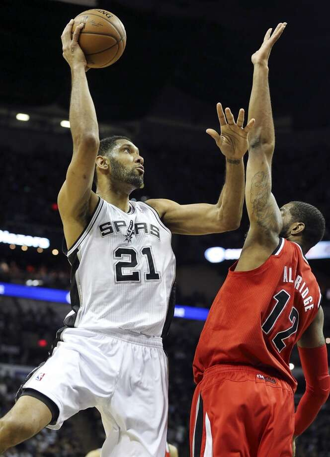 San Antonio Spurs' Tim Duncan shoots around Portland Trail Blazers' LaMarcus Aldridge during first half action of Game 5 in the Western Conference semifinals Wednesday May 14, 2014 at the AT&T Center. Photo: Edward A. Ornelas, San Antonio Express-News