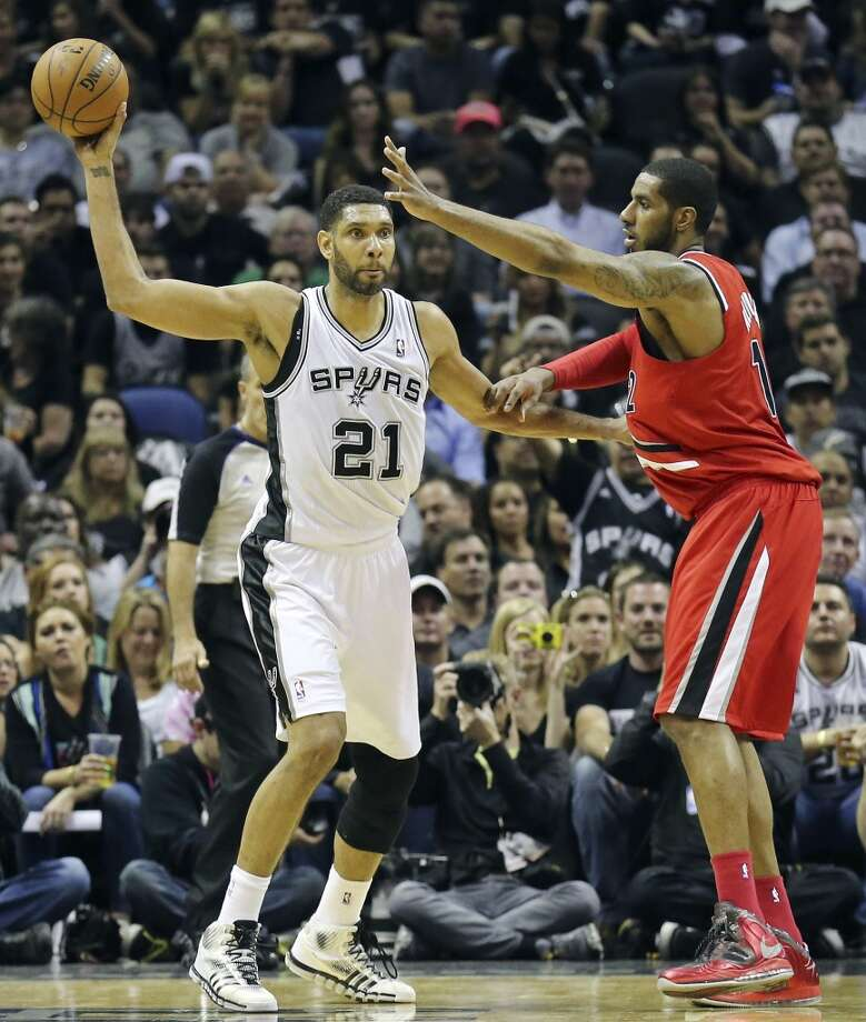 San Antonio Spurs' Tim Duncan looks to pass around Portland Trail Blazers' LaMarcus Aldridge during second half action of Game 5 in the Western Conference semifinals Wednesday May 14, 2014 at the AT&T Center. The Spurs won 104-82. Photo: Edward A. Ornelas, San Antonio Express-News